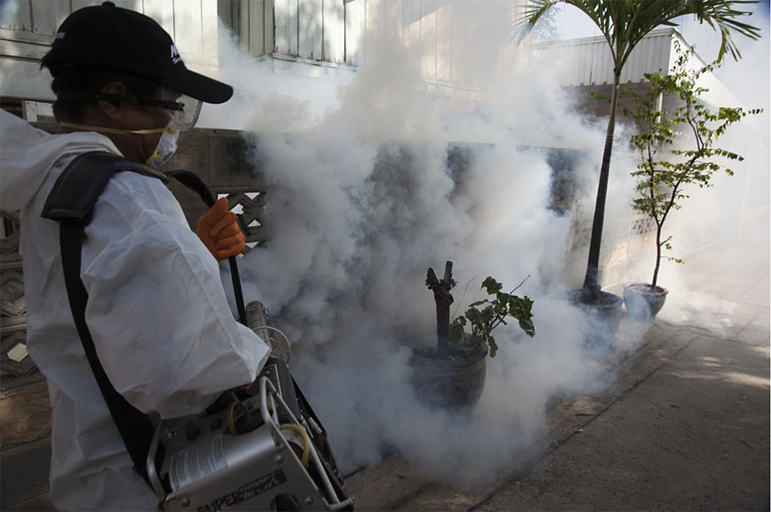 A mosquito repellant fogging operation being carried out by Public Health dengue prevention staff outside Bangkok, June 2012