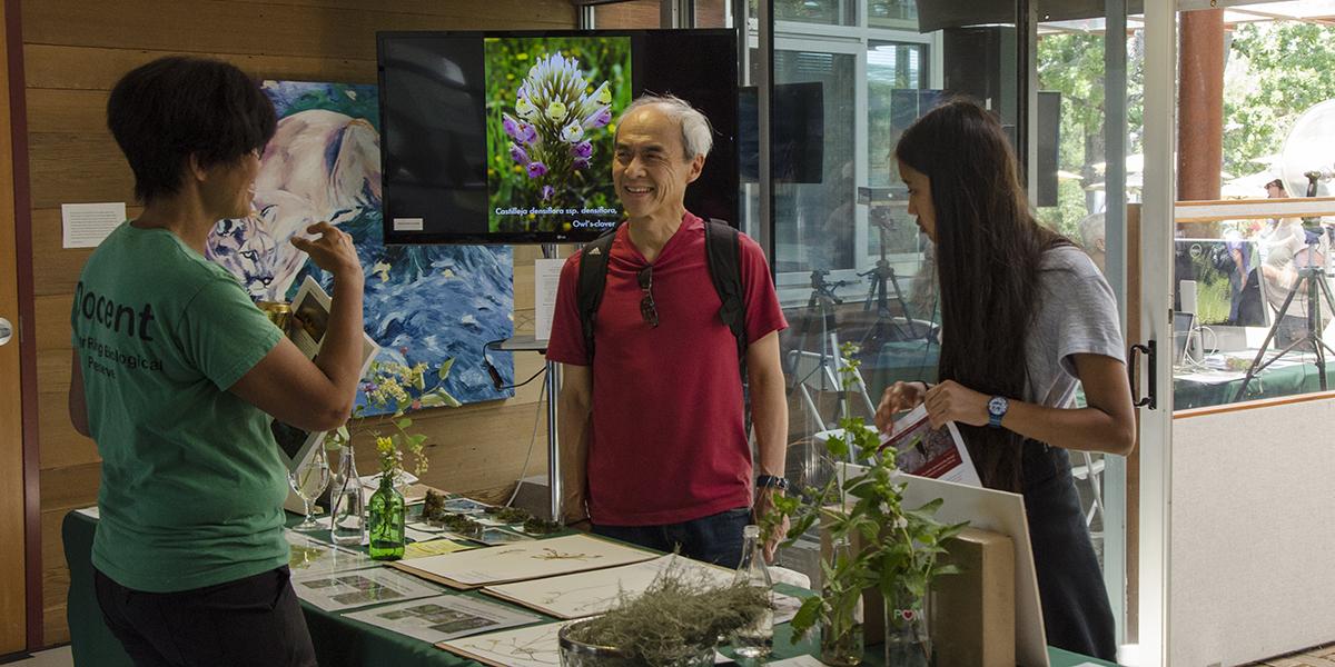 Vivian Neou explaining plant exhibits inside Sun Field Station